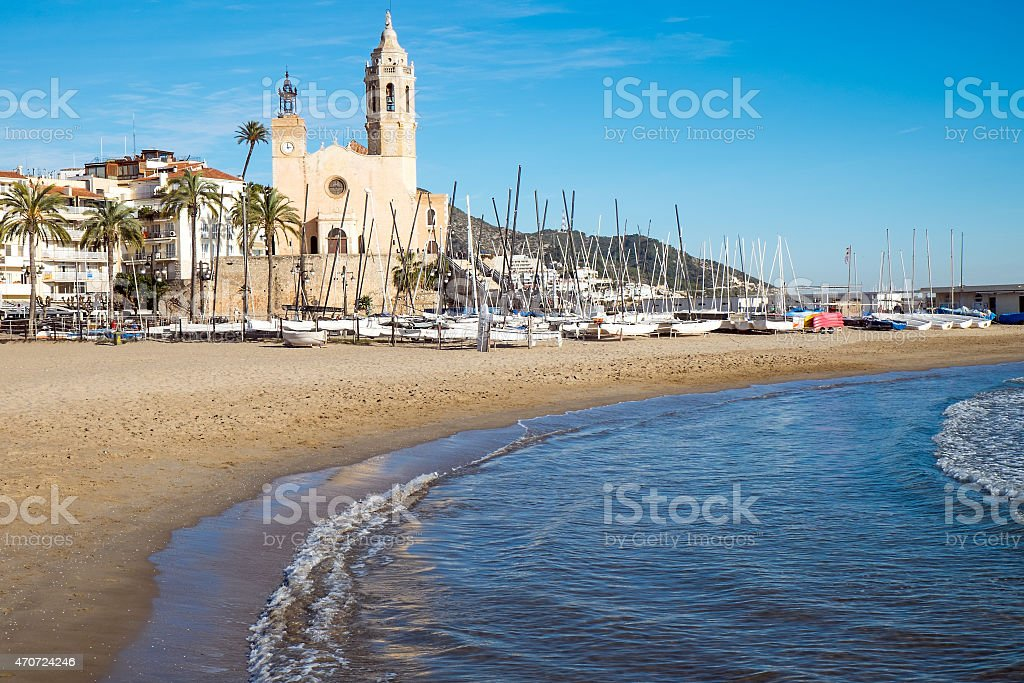 Church and beach in Sitges stock photo
