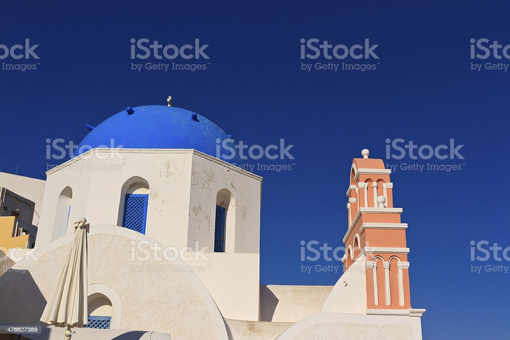 church and bell tower in oia village, Santorini, Greece royalty-free stock photo