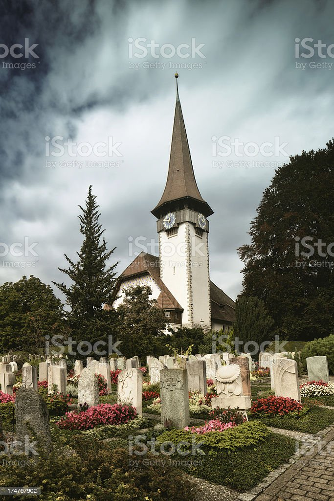 Church and Cemetery under Storm stock photo