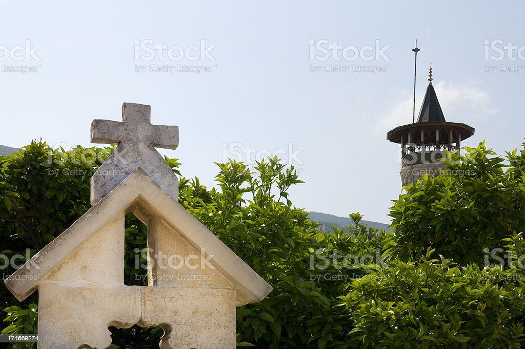 Church and minaret of a mosque in Antakya, Turkey stock photo