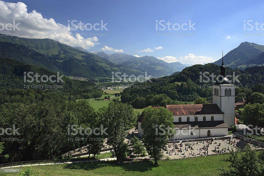 Church and mountains of Gruyeres Switzerland royalty-free stock photo