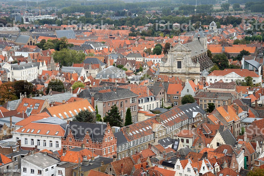 Church and red roofed homes from above in Brugge, Belgium royalty-free stock photo