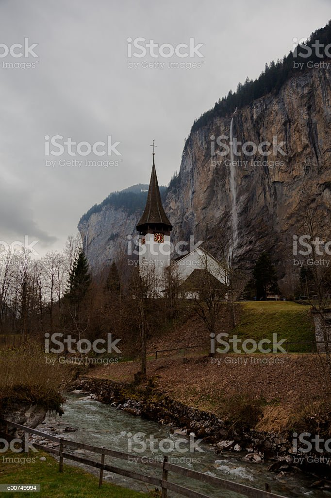 Church and River with waterfall Lauterbrunnen valley Bernese Alps, Switzerland. stock photo