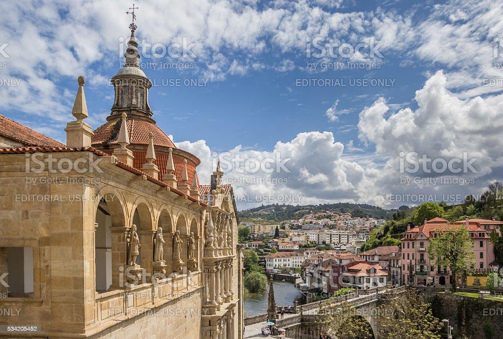 Church and roman bridge in historical town Amarante stock photo