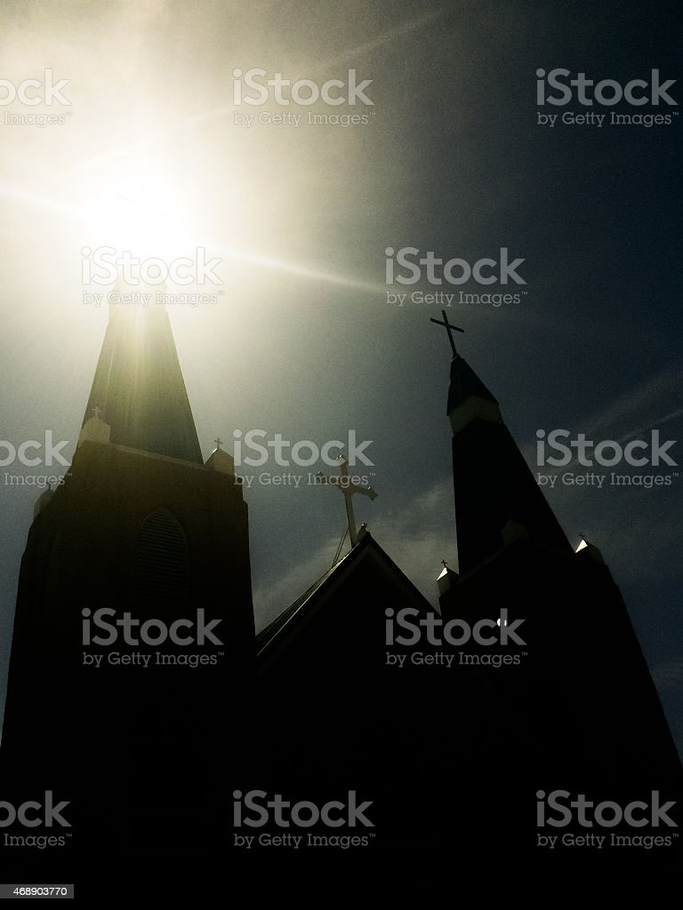 church and sunshine sky with crosses stock photo