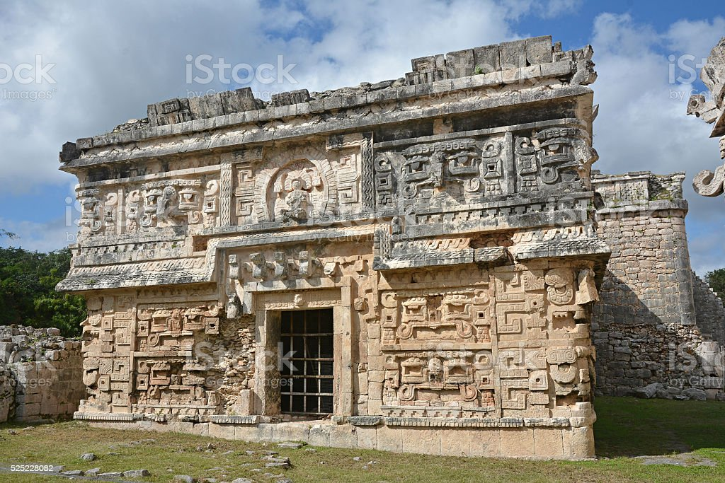 Church and temple of reliefs in Chichen Itza. stock photo