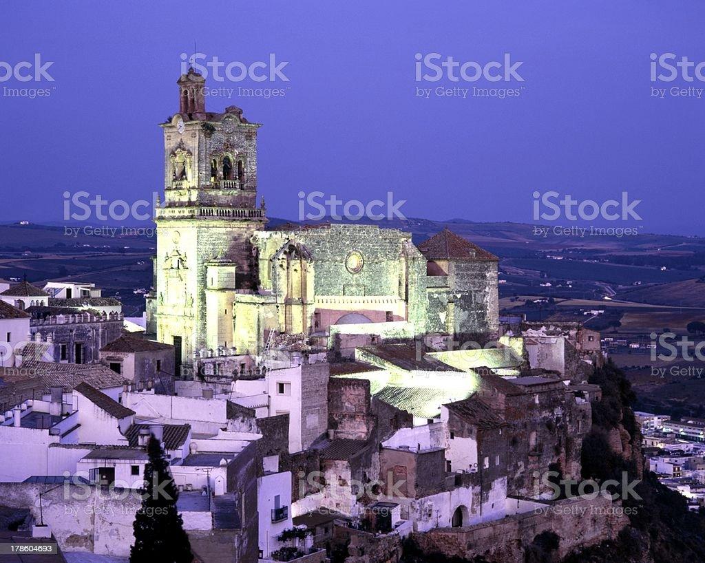 Church and village at dusk, Arcos de la Frontera. stock photo