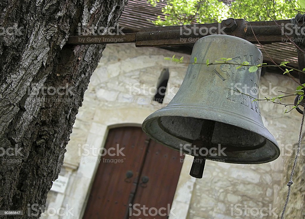 Church Belfry hanging on a tree royalty-free stock photo