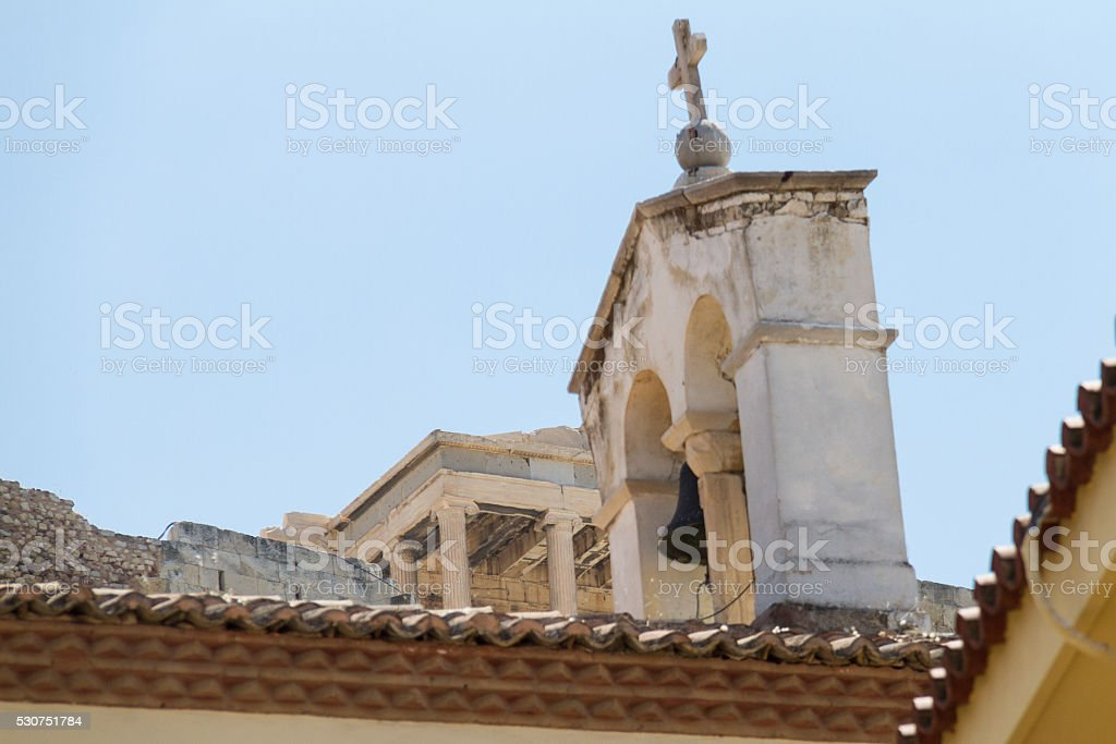 Church bell tower and Acropolis view from Plaka, Athens stock photo