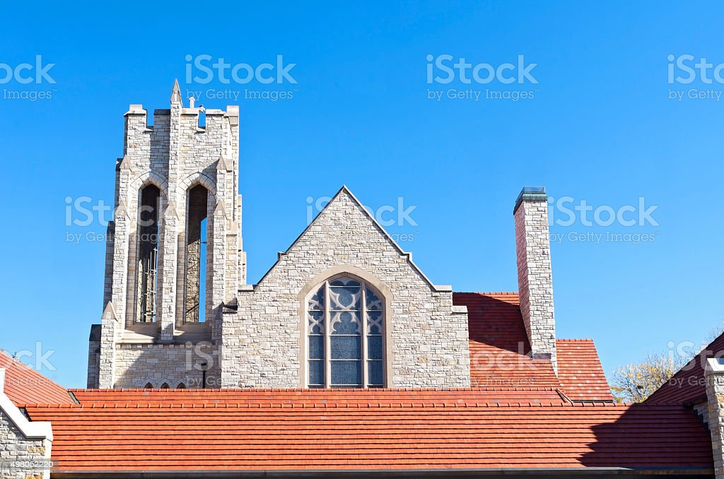 Church Bell Tower and Red Tile Roof stock photo