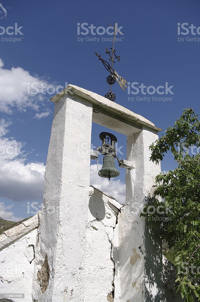 Church bell tower in remote rural Spain. Alpujarras. stock photo