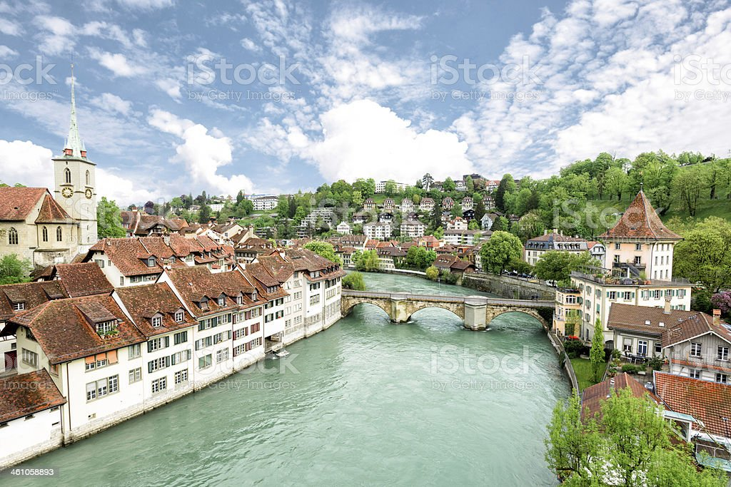 Church, bridge and houses with tiled rooftops, Bern, Switzerland stock photo