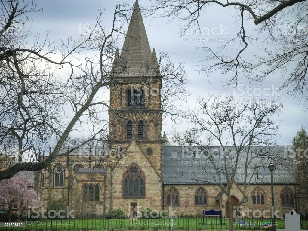 Church building surrounded by Branches of tree stock photo