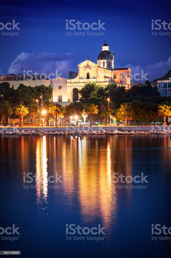 Church by night with water reflction stock photo