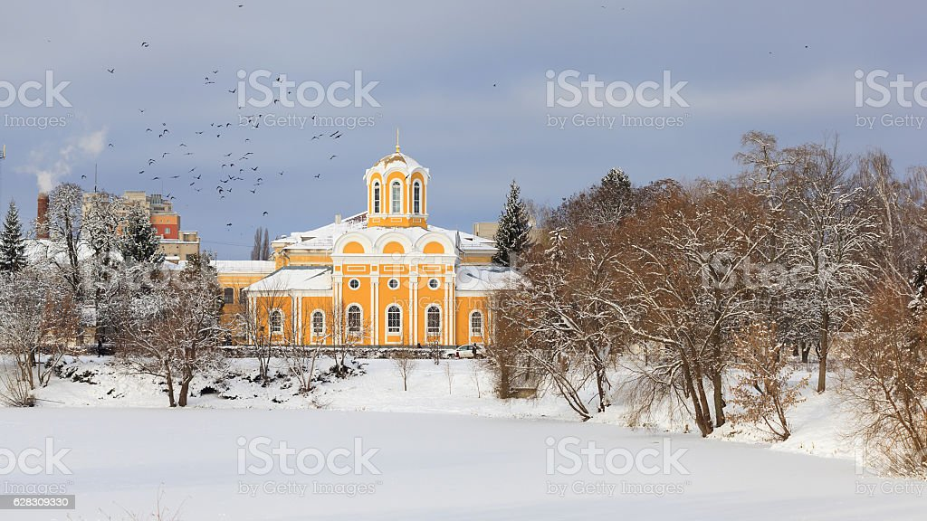 Church by the pond in the winter stock photo