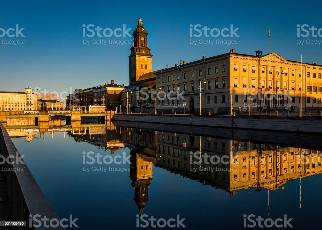 Church by water in morning light stock photo