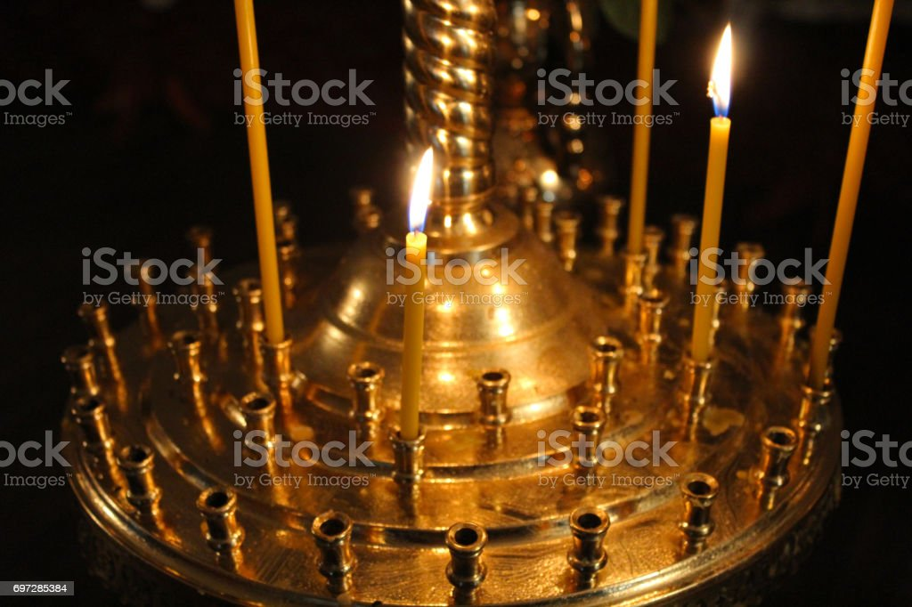 church candles brightly burning stock photo