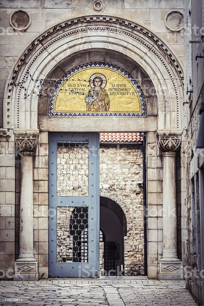 Church entrance in the old coblestone Mediterranean street stock photo