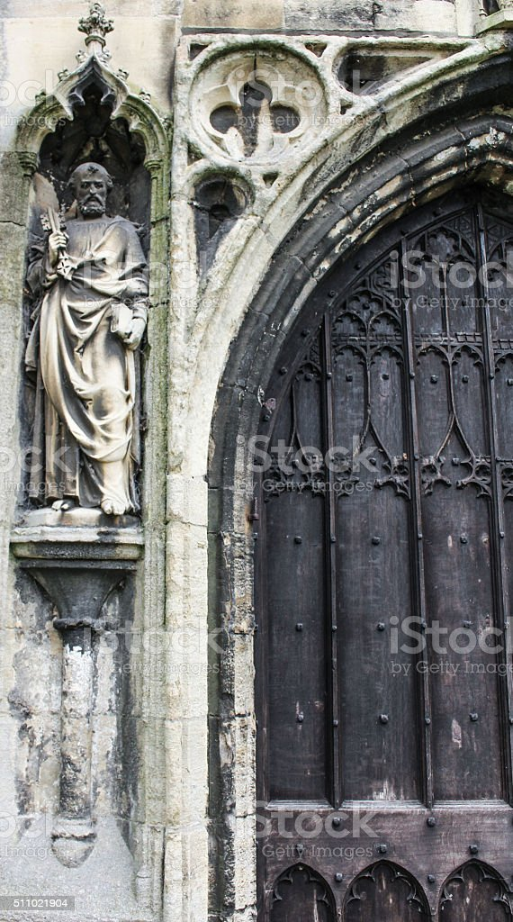 Church Entrance Showing Large Wall Mounted Sculpture stock photo