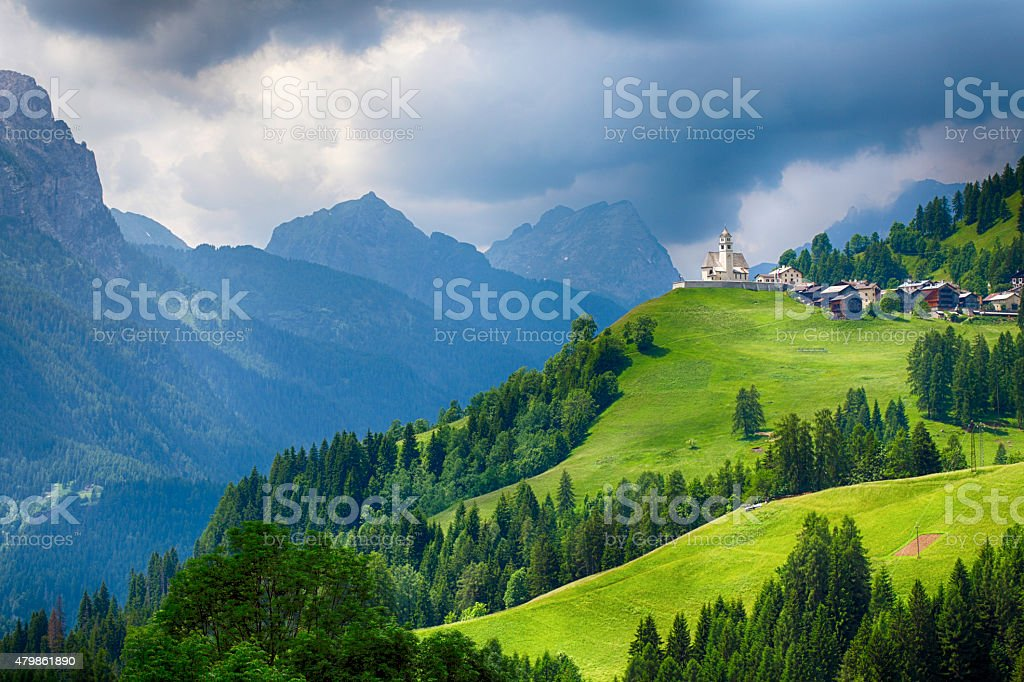 Church in Dolomites alps countryside meadow mountain stock photo