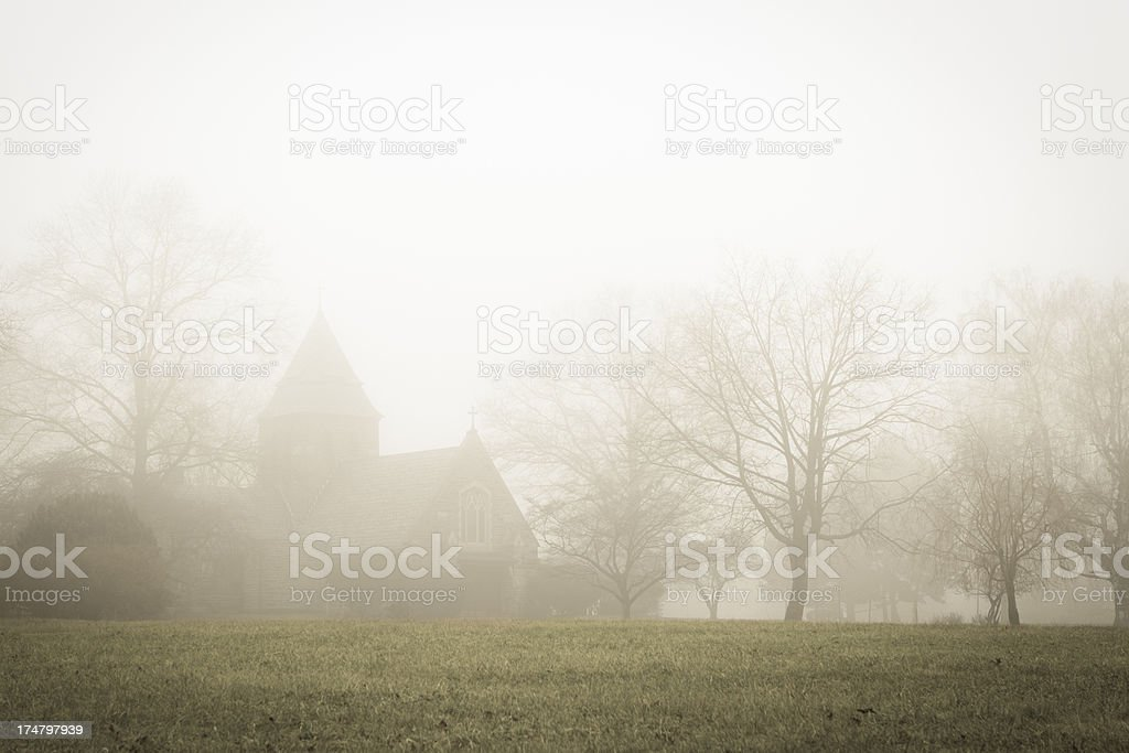 Church in heavy winter fog royalty-free stock photo