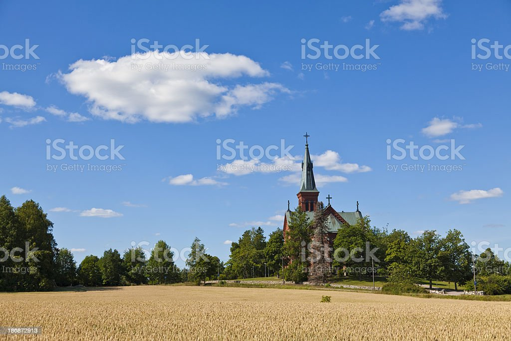 Church in Sipoo Finland summer landscape blue sky and cornfield stock photo