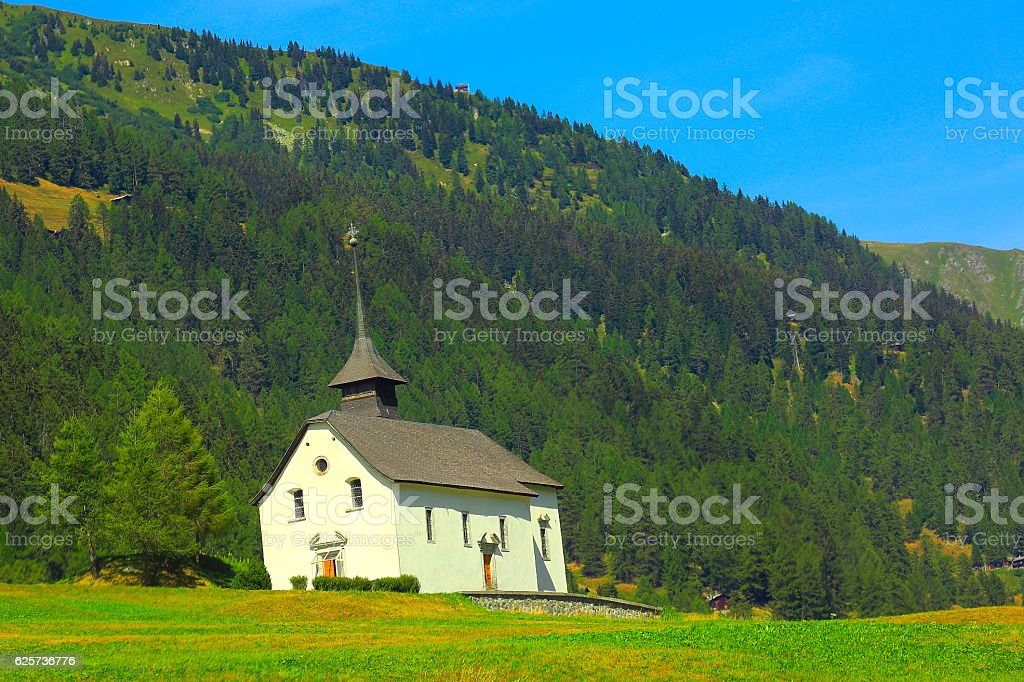 Church in Switzerland alpine paradise coutryside, Gstaad, Swiss alps landscape stock photo