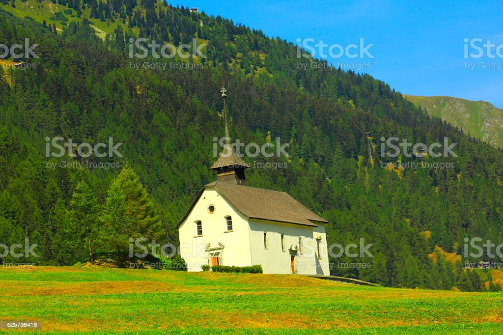 Church in Switzerland alpine paradise Gstaad coutryside, Swiss alps landscape stock photo