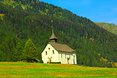 Church in Switzerland alpine paradise Gstaad coutryside, Swiss alps landscape