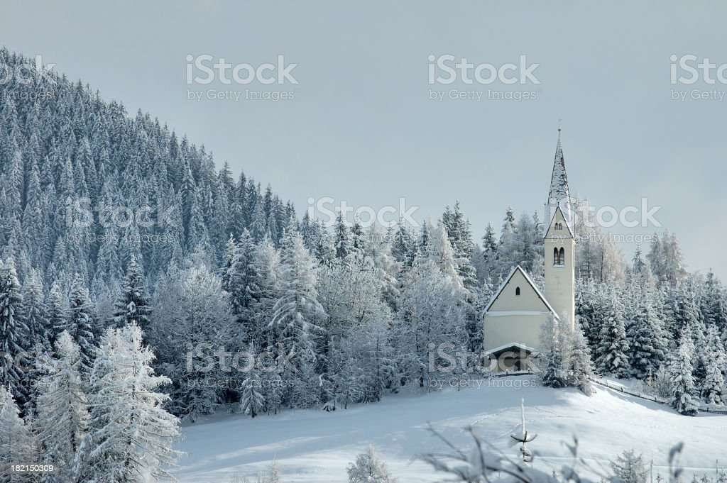 Church in the snow 4/5 stock photo