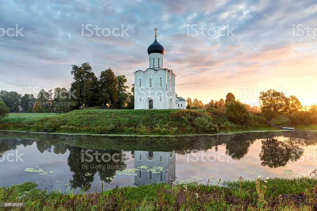 Church Intercession of Holy Virgin on Nerl River at dawn. stock photo