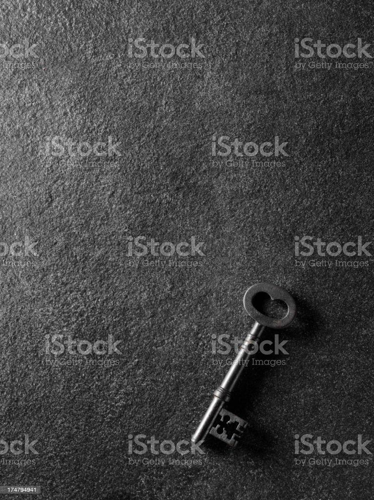 Church Key on a Slate Background royalty-free stock photo