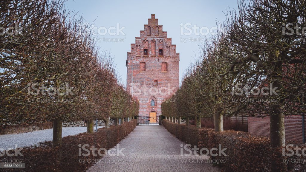 Church (kirke) near Odense (Lunde) in Denmark buried in sand stock photo