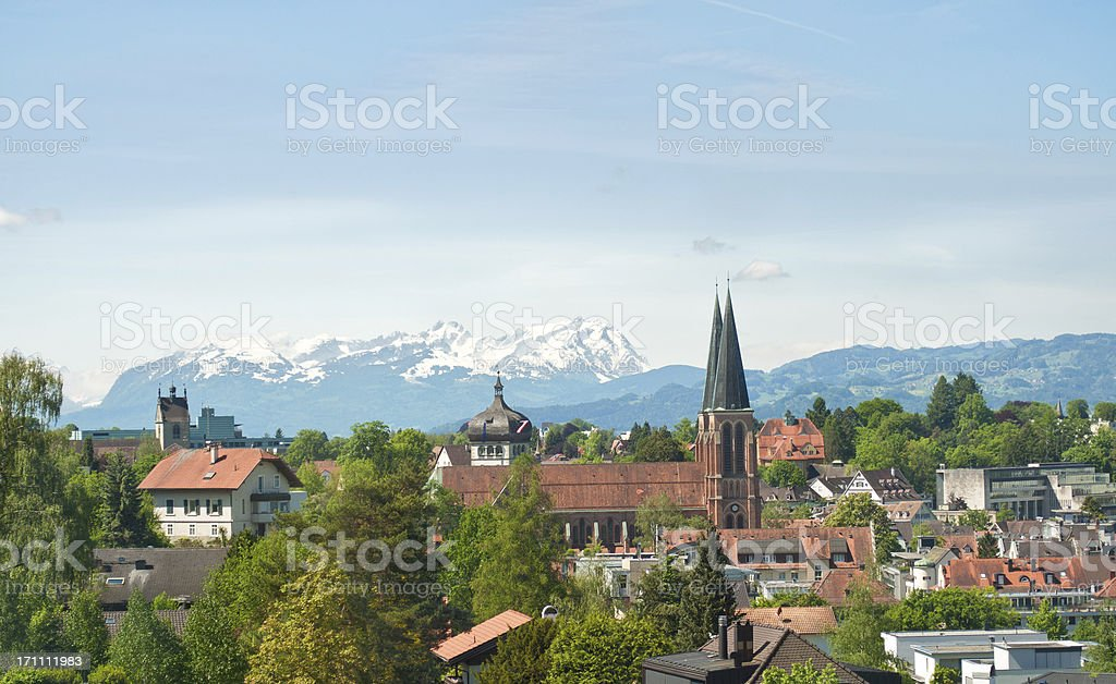 church of Bregenz / Austria and mountain Santis stock photo