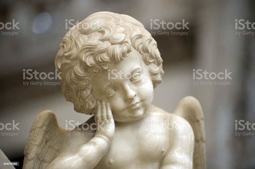 Church of Brou (Bourg-en-Bresse), statue, a sleeping putto royalty-free stock photo