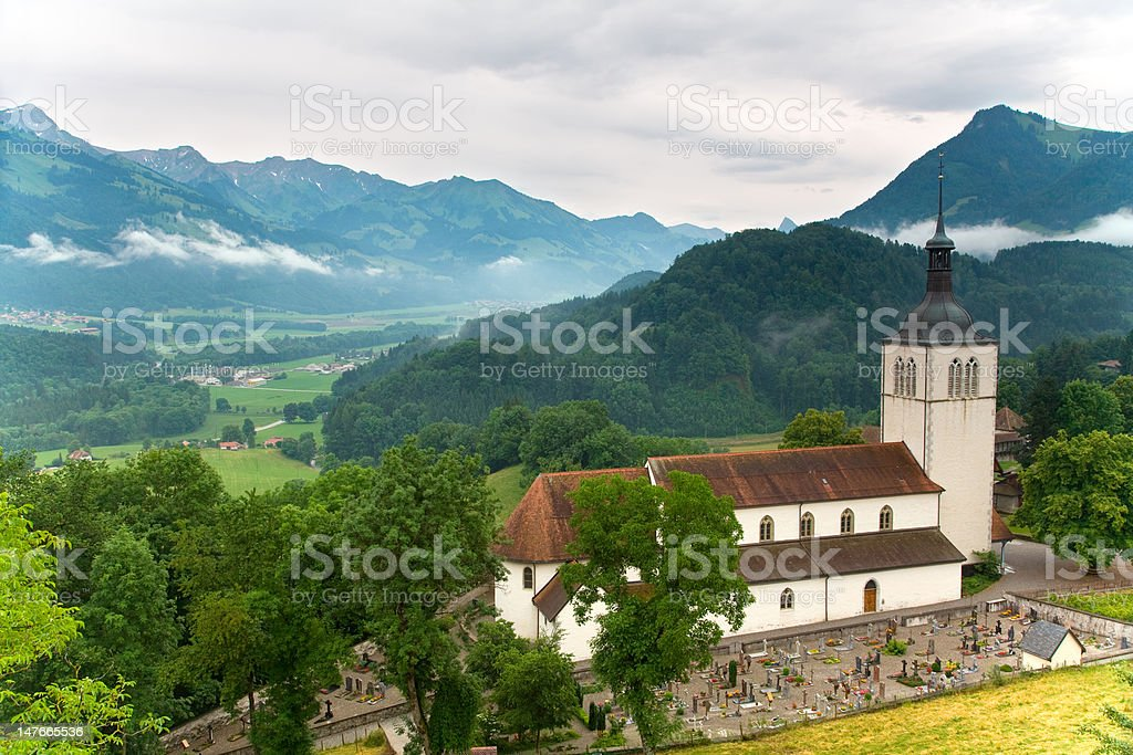 Church of Gruyères in the Fribourg canton , Switzerland royalty-free stock photo