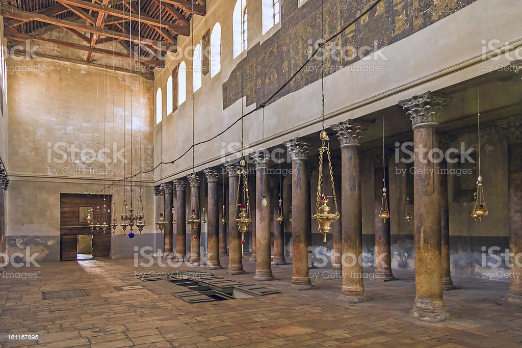 Church of Nativity interior with hall colonnade and icon lamps stock photo