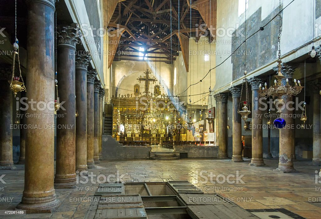Church of Nativity interior with incident Sun ray before iconostasis stock photo