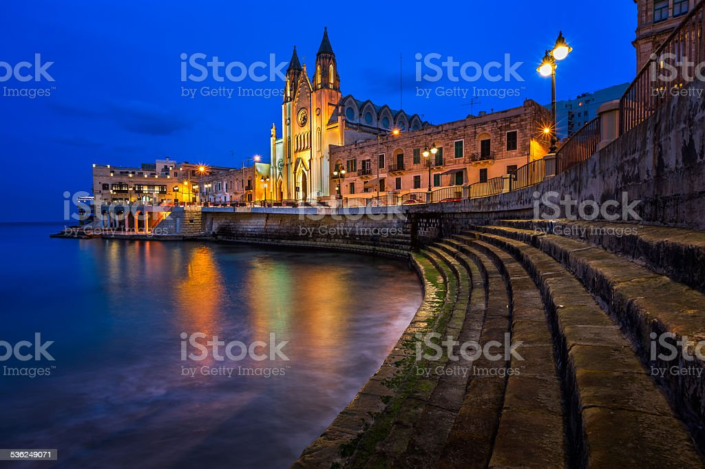 Church of Our Lady of Mount Carmel and Balluta Bay stock photo