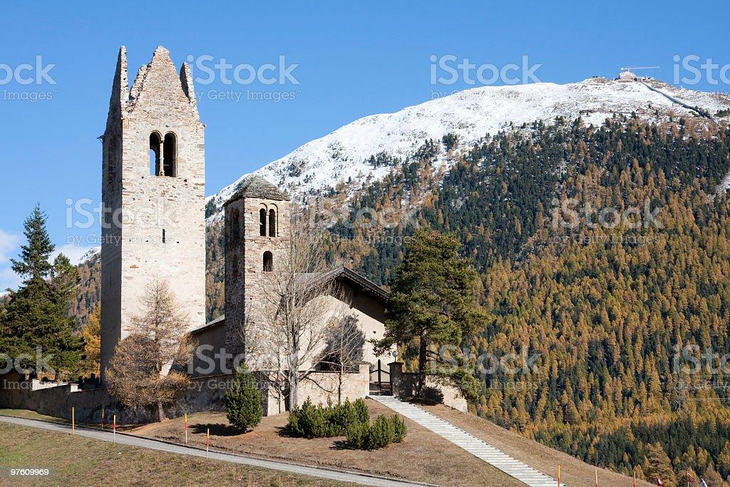 Church of San Gian, Celerina, Engadine, Switzerland in Indian Summer stock photo