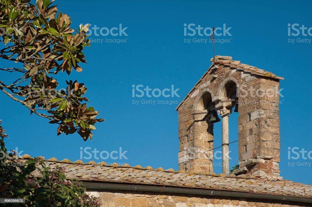 SAN QUIRICO D'ORCIA, ITALY - OCTOBER 30, 2016: Church of Santa Maria Assunta, San Quirico d'Orcia, Tuscany, Italy stock photo