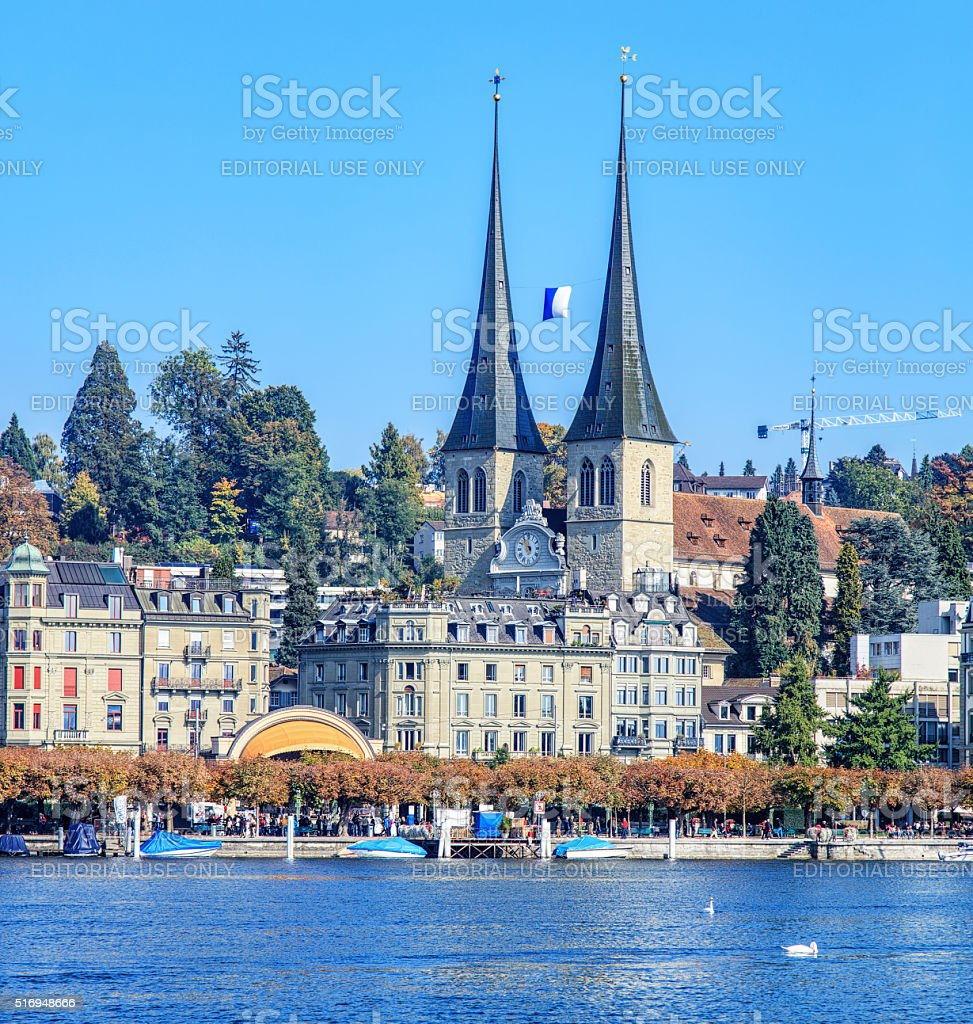 Church of St. Leodegar and the Nationalquai quay in Lucerne stock photo