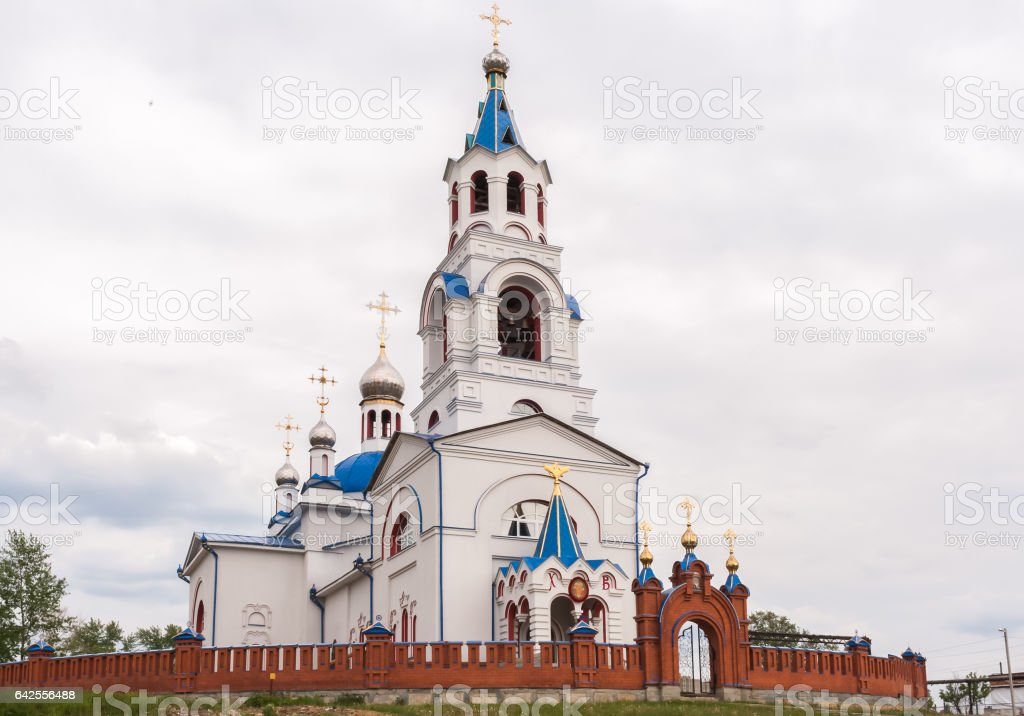 Church of the Dormition at cloudy summer day. Novoutkinsk, Russi stock photo