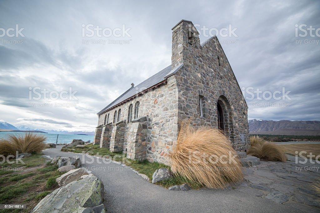 Church of the Good Shepherd and Lake Tekapo, overcast sky stock photo