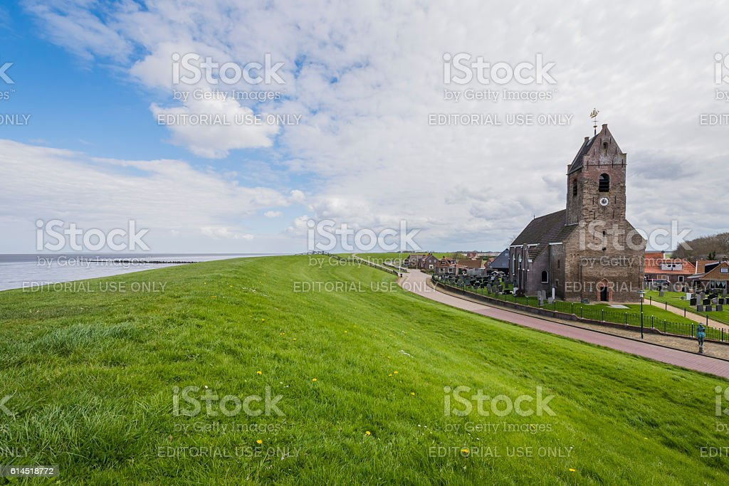 Church of Wierum with Dike, Friesland stock photo