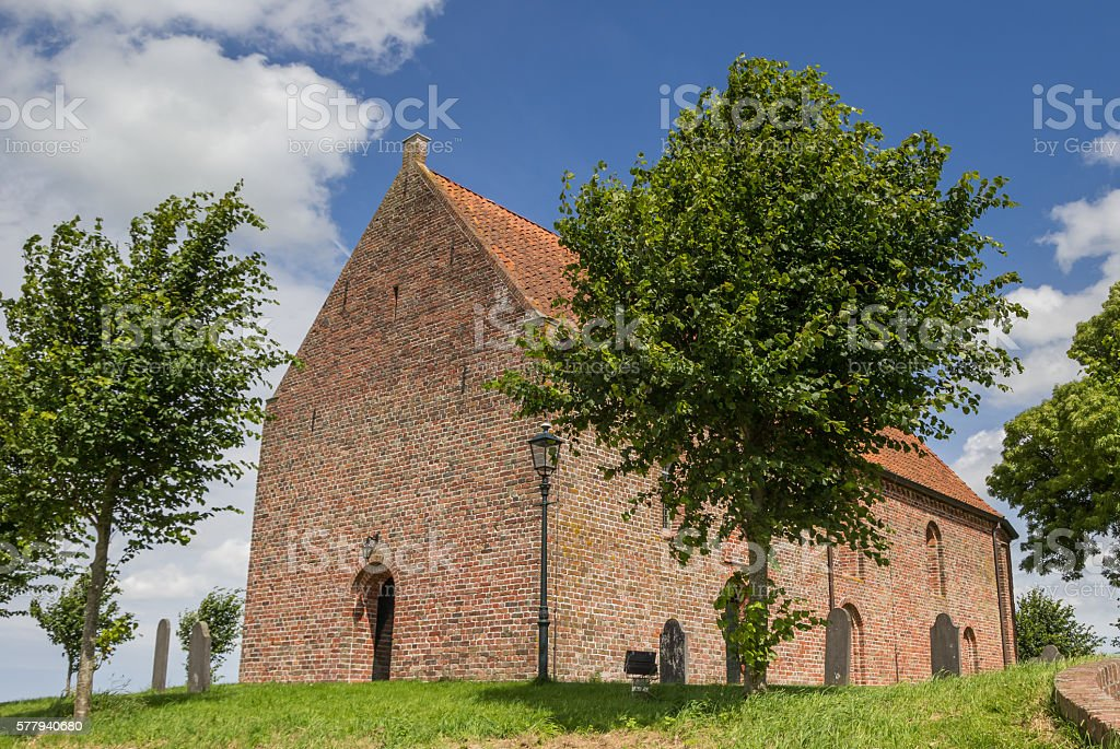 Church on a hilltop in Ezinge stock photo