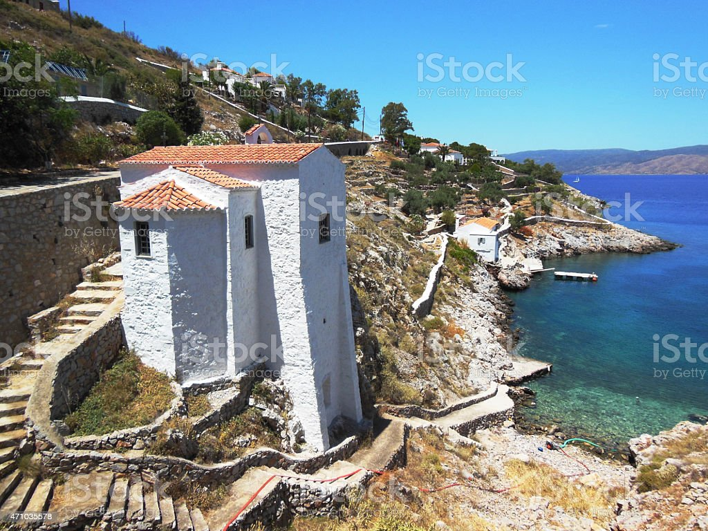 Church on rocks at Hydra Island stock photo