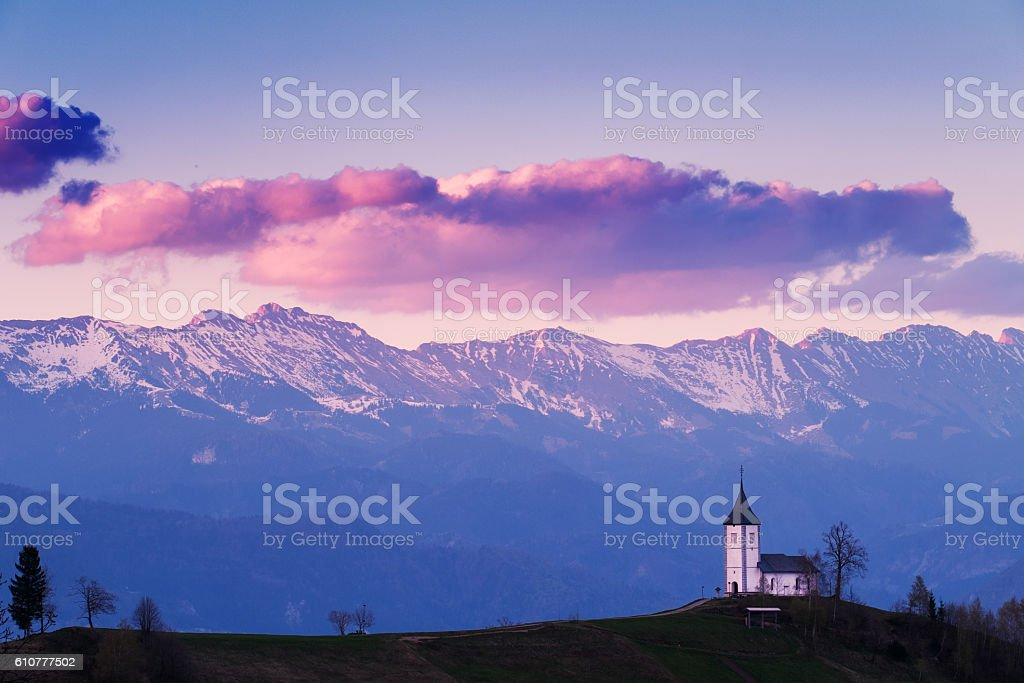 Church on the hill at sunset at Jamnik stock photo