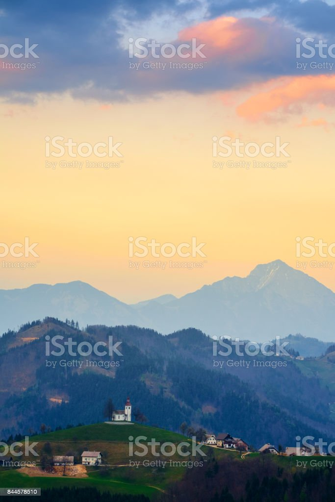 Church on the hill at sunset at Sveti Tomaž, Slovenia stock photo