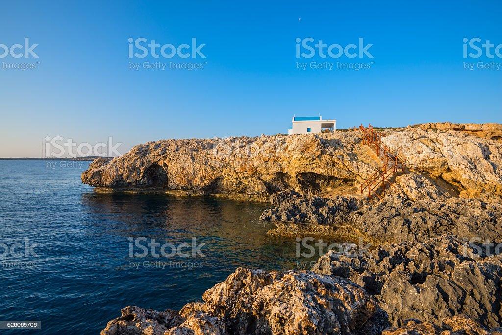 Church on the rocky shore of Mediterranean Sea stock photo